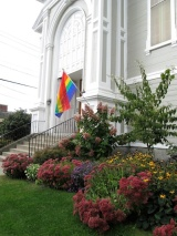 Front of church with rainbow flag