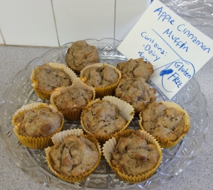 Plate of muffins with sign saying that they are apple cinnamon and listing ingredients